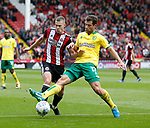 Yanic Wildschut of Norwich City tackles Paul Coutts of Sheffield Utd during the Championship match at Bramall Lane Stadium, Sheffield. Picture date 16th September 2017. Picture credit should read: Simon Bellis/Sportimage