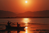 Fisher men in boat at sunset, Madagascar, Africa