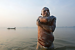 Faggu Ram, a Dalit Weaver, comes to bathe at the Varuna Sangam every morning before going to the temple to pray. Nowadays, because scientists have found so much pollution in the Ganga, people who bathe regularly its waters are at risk of infection.
