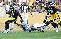 PITTSBURGH - SEPTEMBER 18:  Rashard Mendenhall #34 of the Pittsburgh Steelers runs while avoiding a tackle by David Hawthorne #57 of Seattle Seahawks during the game on September 18, 2011 at Heinz Field in Pittsburgh, Pennsylvania.  (Photo by Jared Wickerham/Getty Images)