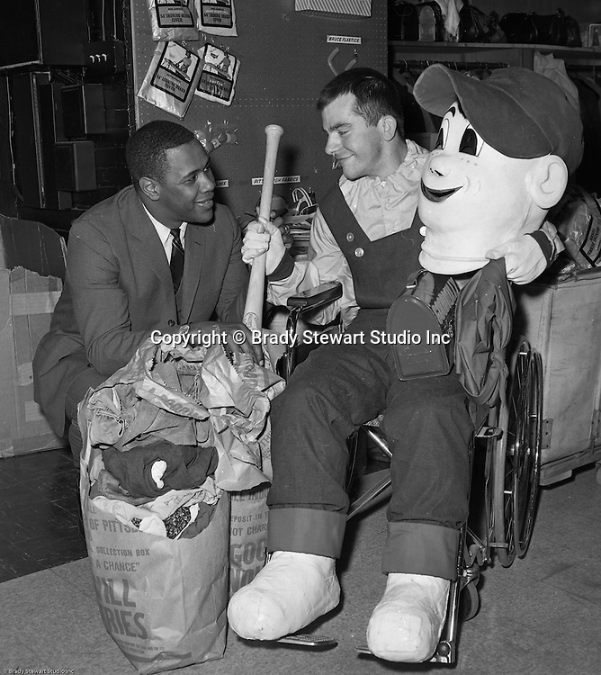 Pittsburgh PA:  Willie Stargell giving an autographed baseball bat to &quot;Good Willie&quot; at Goodwill Industries - 1966.<br /> In 1966, Goodwill Industries was part of the United Fund Community Chest Agency which eventually became the United Way of Allegheny County in 1974. Goodwill Industries provides a broad array of employment-related education and workforce development programs and services for people with physical and intellectual disabilities and other barriers to employment.