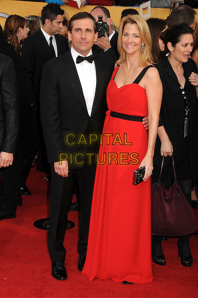 STEVE CARELL & NANCY WALLS.17th Annual Screen Actors Guild Awards held at The Shrine Auditorium, Los Angeles, California, USA..January 30th, 2011.SAG arrivals full length tuxedo red dress married husband wife clutch bag bow black white tie .CAP/ADM/BP.©Byron Purvis/AdMedia/Capital Pictures.