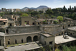 Herculanem (Ercolano) Italy stands below its nemesis, Mount  Vesuvius in the background.  Herculanem was entombed by the pyroclastic flow in AD 79.