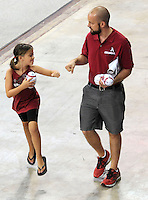 NWA Media/ANDY SHUPE - Chad Hudson of Fayetteville, right, and his 8-year-old daughter Riley bump fists to celebrate after having some items autographed during the annual  University of Arkansas Fan Day Sunday, Aug. 17, 2014, at Bud Walton Arena in Fayetteville. The day featured opportunities to have items autographed by members of the Razorbacks volleyball, soccer, football teams, mascots and the spirit squads. Visit photos.nwaonline.com to see more photos from the event.