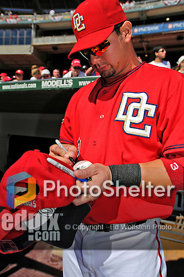 23 September 2007: Washington Nationals catcher Jesus Flores signs an autograph prior to the historic last professional baseball game played at Robert F. Kennedy Memorial Stadium in Washington, DC. The Nationals defeated the visiting Philadelphia Phillies 5-3 to close out the home season at RFK.. .Mandatory Photo Credit: Ed Wolfstein Photo