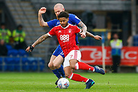 Aron Gunnarsson of Cardiff City challenges Liam Bridcutt of Nottingham Forest during the Sky Bet Championship match between Cardiff City and Nottingham Forest at the Cardiff City Stadium, Wales, UK. Saturday 21 April 2018