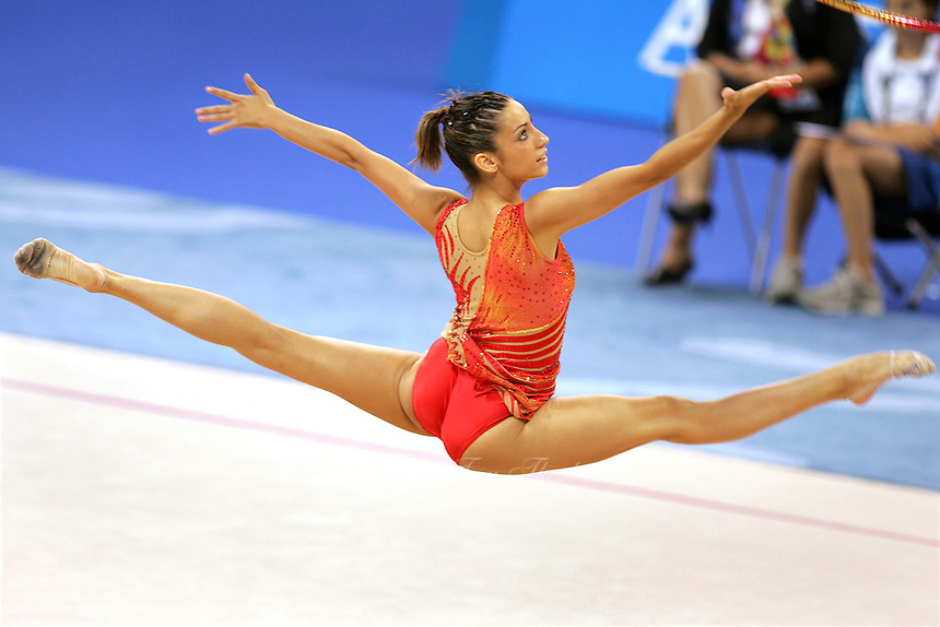 August 29, 2004; Athens, Greece; Rhythmic gymnastics star ALMUDENA CID of Spain split leaps to recatch hoop in All-Around competition at 2004 Athens Olympics. Almudena Cid has made history by being the only rhythmic gymnast ever to make 3 Olympic finals.<br />