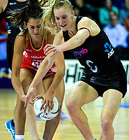 England wing defence Beth Cobden beats Shannon Francois to the ball during the Quad Series netball match between the New Zealand Silver Ferns and England Roses at Trusts Stadium, Auckland, New Zealand on Wednesday, 30 August 2017. Photo: Dave Lintott / lintottphoto.co.nz