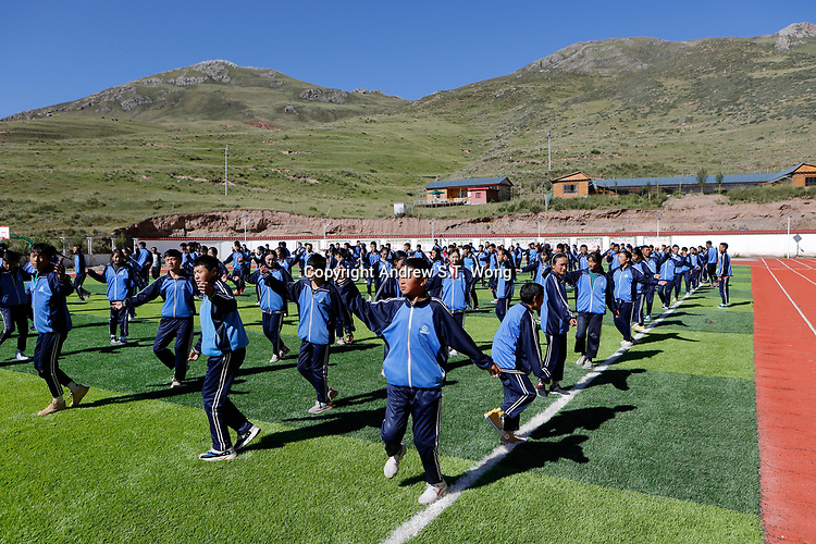 Nangqen County, Yushu Tibetan Autonomous Prefecture, Qinghai Province, China - Tibetans students perform traditional dance as part of morning exercise at a vocational training school, August 2019.