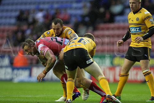 06.07.2011 Engage Super League Rugby from the DW Stadium. Wigan Warriors v Castleford Tigers. Josh Charnley dives through a tackle from John Davies...