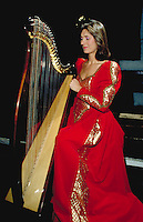A young woman plays the harp at an Irish banquet in Bunratty Castle. These female performers are known as the Belles of Bunratty. Bunratty, Ireland Bunratty Castle.