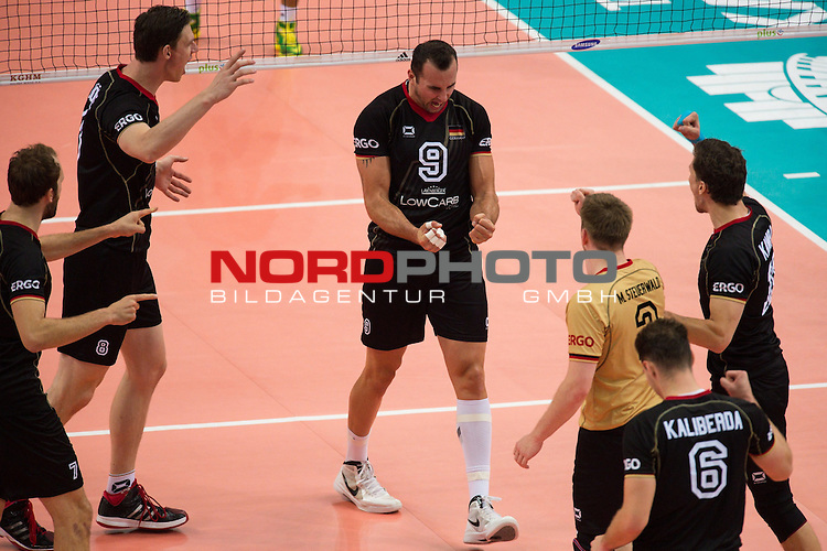 17.09.2014, Spodek, Kattowitz<br /> Volleyball, FIVB Volleyball Men`s World Championship 2014, 3. Runde, Deutschland (GER) vs. Iran (IRI)<br /> <br /> Jubel Dirk Westphal (#7 GER), Marcus B&ouml;hme / Boehme (#8 GER), Georg / Gy&ouml;rgy / Gyoergy Grozer (#9 GER), Denis Kaliberda (#6 GER), Markus Steuerwald (#2 GER), Lukas Kampa (#11 GER)<br /> <br />   Foto &copy; nordphoto / Kurth
