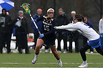 01 March 2015: Notre Dame's Cortney Fortunato (15) and Duke's Maura Schwitter (50. The Duke University Blue Devils hosted the University of Notre Dame Fighting Irish on the West Turf Field at the Duke Athletic Field Complex in Durham, North Carolina in a 2015 NCAA Division I Women's Lacrosse match. Duke won the game 17-3.