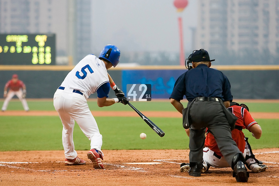 20 August 2007: #5 Kenji Hagiwara connects for a hit during the Czech Republic 6-1 victory over France in the Good Luck Beijing International baseball tournament (olympic test event) at the Wukesong Baseball Field in Beijing, China.