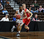 SIOUX FALLS, SD - MARCH 12:  Jaylen McKay #11 from IU East gets a step past Trevor Waite #13 from Indiana Wesleyan during their semifinal game at the 2018 NAIA DII Men's Basketball Championship at the Sanford Pentagon in Sioux Falls. (Photo by Dave Eggen/Inertia)