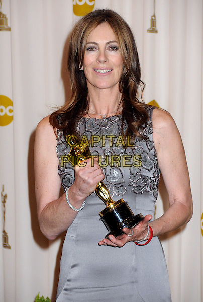 KATHRYN BIGELOW  .82nd Annual Academy Awards held at the Kodak Theatre, Hollywood, California, USA..March 7th, 2010.oscars half length  silver grey gray dress sleeveless winner trophy.CAP/ADM/BP.©Byron Purvis/AdMedia/Capital Pictures.