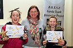 JEssica Woods Left who was injured in the explosion in Drogheda.<br /> Picture www.newsfile.ie<br /> <br /> Garda Anita O'Shea with Molly Crosbie and Jessica Woods who won awards for Best Attendance at the Boyne Garda Youth Project Awards in the Holy Family Community Centre...Photo NEWSFILE/Jenny Matthews..(Photo credit should read Jenny Matthews/NEWSFILE)