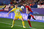Atletico de Madrid´s Siqueira (R) and Astana´s Akhmetov during Champions League soccer match between Atletico de Madrid and FC Astana at Vicente Calderon stadium in Madrid, Spain. October 21, 2015. (ALTERPHOTOS/Victor Blanco)