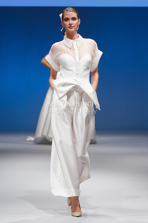 Model walks runway in a Gemy Maalouf Bridal gown at the Designers Spotlight Pier 94 runway show on October 9, 2016; for New York International Bridal Week, during New York Bridal Fashion Week.