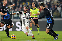 Calcio, Ottavi di finale di Tim Cup: Juventus vs Atalanta. Torino, Juventus Stadium, 11 gennaio 2017.<br /> Juventus&rsquo; Miralem Pjanic, center, is challenged by Atalanta's Mattia Caldara, right, during the Italian Cup football round of 16 match between Juventus and Atalanta at Turin's Juventus Stadium, 8 January 2017. Juventus won 3-2 to join the quarter finals.<br /> UPDATE IMAGES PRESS/Manuela Viganti