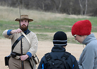 NWA Democrat-Gazette/DAVID GOTTSCHALK Matt Hulheran, park interpreter at Prairie Grove Battlefield State Park, dressed in a Confederate Infantry Uniform, demonstrates Wednesday, November 28, 2018, the loading and firing of a Civil War era gun, before a hike through a section of the Battle of Cane Hill on the Heritage Trail in Cane Hill. The battle of Can Hill, on November 28, 1862 is considered the prelude to the Battle of Prairie Grove. Prairie Grove Battlefield State Park will host the annual Battle of Prairie Grove Reenactment this Saturday and Sunday and will feature a reenactment of the battle and living history programs.