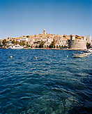 CROATIA, Korcula, Dalmatian Coast, waterfront with buildings in the background in Korcula.