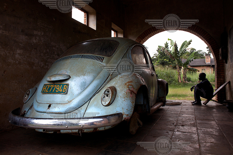 An old Volkswagon Beetle sits in the garage of a residential home on Yamgambi Research Station. The station contains 250 residential homes, some are derelict but most are inhabited by more than one family. These are usually workers at the facility who are assigned the homes by the Ministry of Agriculture in Kinshasa.