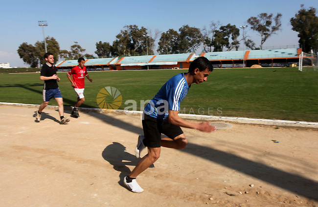 Palestinian runner Bahaa al-Farra, who has been selected to represent Palestine at the London Olympics in July - August 2012 during training at the al-Yarmouk soccer stadium in Gaza City on March 29, 2012. Farra will be one of a four-strong Palestinian team, which is eligible to compete in the Games under rules which exempt developing nations from qualifying, but he is Gaza's only participant. Photo by Ashraf Amra