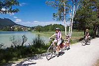 Germany, Bavaria, Swabia, East-Allgaeu, Fuessen: district Weissensee-Oberkirch at Lake Weissensee with daughter church St. Nikolaus, family trip by bike | Deutschland, Bayern, Schwaben, Ost-Allgaeu, Fuessen, Ortsteil Weissensee-Oberkirch am Weissensee mit Filialkirche St. Nikolaus: Familienausflug per Fahrrad