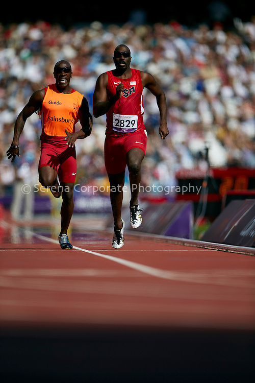 Josiah Jamison of the USA completes the men's T12 200m heat with the help of his guide, Jerome Avery..London Paralympic Games - Athletics 7.9.12