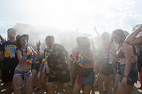 Revellers cool down in a spray of water as they party in the record heat in front of the Main Stage at Sziget Festival held in Budapest, Hungary on Aug. 13, 2018. ATTILA VOLGYI