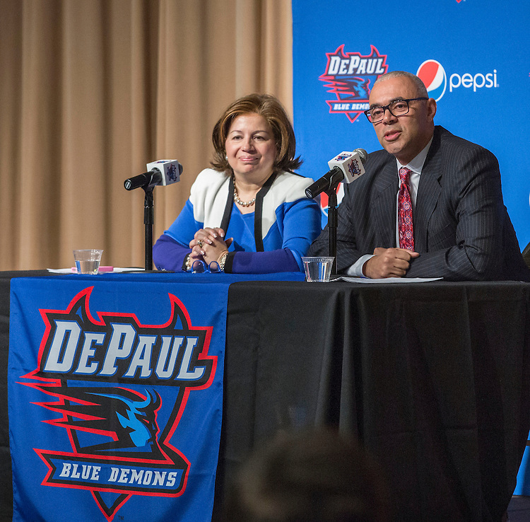 Introduced by Athletics Director Jean Lenti Ponsetto, left, Dave Leitao greets the crowd and media as DePaul University's new head coach of the men's basketball program during a press conference Monday, March 30, 2015. (DePaul University/Jamie Moncrief)