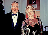 United States Attorney General Edwin Meese, III, left, and his wife, Ursula, right, arrive for the State Dinner in honor of President Jose Napoleon Duarte of El Salvador hosted by United States President Ronald Reagan and first lady Nancy Reagan at the White House in Washington, DC on October 14, 1987.<br /> Credit: Ron Sachs / CNP