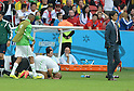 Islam Slimani (ALG),  Hong Myung-Bo (KOR),<br /> JUNE 22, 2014 - Football / Soccer :<br /> Islam Slimani of Algeria prays after scoring the opening goal as South Korea's head coach Hong Myung-Bo looks on during the FIFA World Cup Brazil 2014 Group H match between South Korea 2-4 Algeria at Estadio Beira-Rio in Porto Alegre, Brazil. (Photo by SONG Seak-In/AFLO)