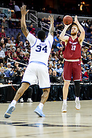 Washington, DC - MAR 10, 2018: Saint Joseph's Hawks forward Anthony Longpre' (12) shoots a basket over Rhode Island Rams forward Andre Berry (34) during semi final match up of the Atlantic 10 men's basketball championship between Saint Joseph's and Rhode Island at the Capital One Arena in Washington, DC. (Photo by Phil Peters/Media Images International)