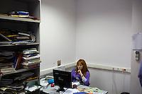 A news editor works at her desk at Komsomolskaya Pravda in Moscow, Russia.