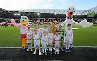 Children mascots with Cyril and Cybil the swans before the Barclays Premier League match between Swansea City and Arsenal at the Liberty Stadium, Swansea on October 31st 2015