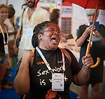 A woman gestures during a demonstration by sex workers and their allies during the 2018 International AIDS Conference in Amsterdam, Netherlands.
