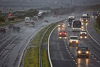 Pictured: Traffic moves slow due to the poor driving conditions on the eastbound carriageway of M4 motorway between junctions 37 and 38 near Pyle in south Wales, UK. Friday 12 October 2018<br /> Re: Strong winds and rain caused by Storm Callum in south Wales, UK.