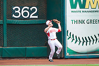 Houston Cougars left fielder Landon Appling #1 catches a fly ball just in front of the 362' sign against the Texas Tech Red Raiders at Minute Maid Park on February 28, 2014 in Houston, Texas.  The Cougars defeated the Red Raiders 9-0.  (Brian Westerholt/Four Seam Images)