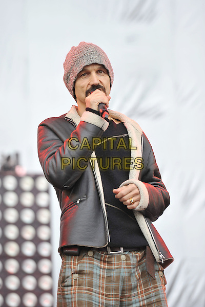 Tim Booth of James .Performing live at Hard Rock Calling, Hyde Park London, England, UK, .June 24th 2011..music festival concert gig on stage half length microphone singing  leather sheepskin aviator jacket beanie hat  grey gray brown plaid checked trousers  .CAP/MAR.© Martin Harris/Capital Pictures.