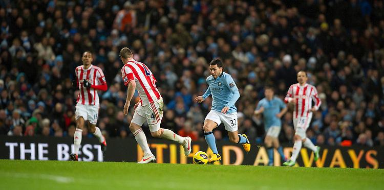 Manchester City's Carlos Tevez attacks the Stoke City defense..Football - Barclays Premiership - Manchester City v Stoke City - Tuesday 1st January  2013 - Etihad Stadium - Manchester..