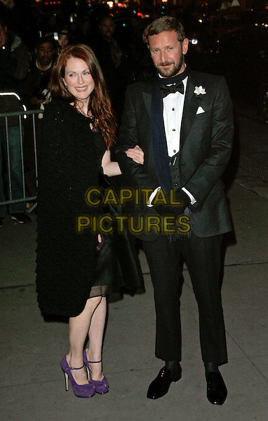 "JULIANNE MOORE & BART FREUNDLICH (?).At Fashion Group International 23rd Annual Night of Stars Honoring ""The Visionaries"" at Cipriani 42nd, New York, New York, USA..October 26th, 2006.Ref: ADM/JL.full length black coat tuxedo scarf gloves purple shoes arms linked .www.capitalpictures.com.sales@capitalpictures.com.©Jackson Lee/AdMedia/Capital Pictures."