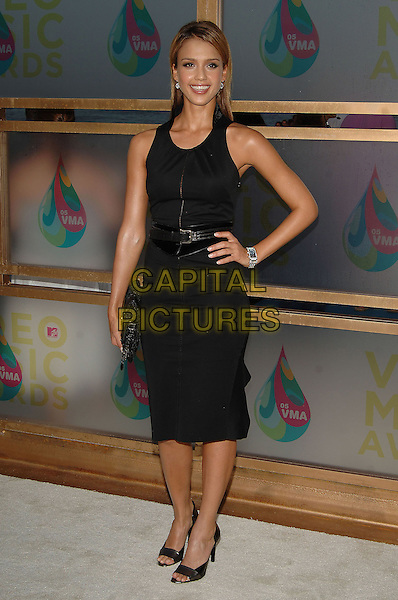 JESSICA ALBA.MTV Video Music Awards.Arrivals held at the American Airlines Arena,.Miami, 28th August 2005.full length black dress belt open toe high heel shoes clutch bag purse.Ref: ADM/JW.www.capitalpictures.com.sales@capitalpictures.com.© Capital Pictures.v-neck plunging neckline