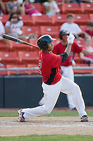 Leonel De Los Santos #2 of the Hickory Crawdads follows through on his swing against the Rome Braves at  L.P. Frans Stadium May 23, 2010, in Hickory, North Carolina.  The Rome Braves defeated the Hickory Crawdads 5-1.  Photo by Brian Westerholt / Four Seam Images