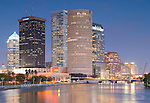 Downtown Tampa reflects in the Hillsborough river at dusk.