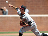 Maryland pitcher Jake Stinnett (7) throws the ball in the third inning of an NCAA college baseball tournament super regional game against Maryland in Charlottesville, Va., Saturday, June 7, 2014. Maryland defeated Virginia 5-4. (AP Photo/Andrew Shurtleff)