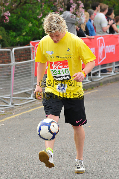 GUEST.Virgin London Marathon, Blackheath, London, England..April 17th, 2011.full length yellow t-shirt soccer football bounce bouncing black shorts .CAP/CAS.©Bob Cass/Capital Pictures.