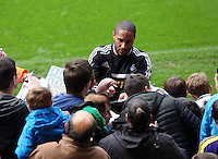Wednesday, 23 April 2014<br /> Pictured: Ashley Williams signing autographs for supporters.<br /> Re: Swansea City FC are holding an open training session for their supporters at the Liberty Stadium, south Wales,