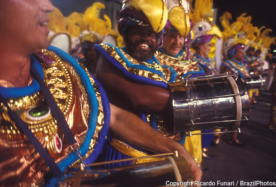 Samba Schools Parade, drummers playing samba - Cuica players - Afro-Brazilian percussion instrument resembling a small barrel and producing a grunting noise - Rio de Janeiro Carnival, Brazil.